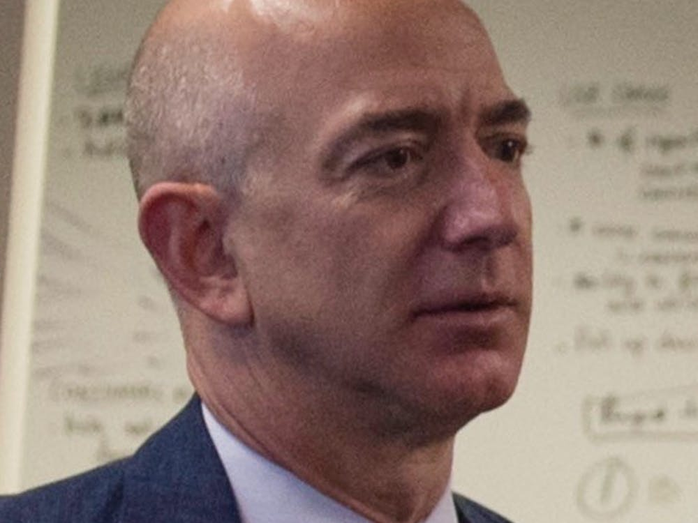 Secretary of Defense Ash Carter (right) speaks with Jeff Bezos, Founder, Chairman & CEO of Amazon.com (second from left) and head of Defense Digital Service Chris Lynch(left) as they visit the Defense Digital Service as Bezos visits the Pentagon May 5 , 2016. (DoD photo by Senior Master Sgt. Adrian Cadiz)(Released)