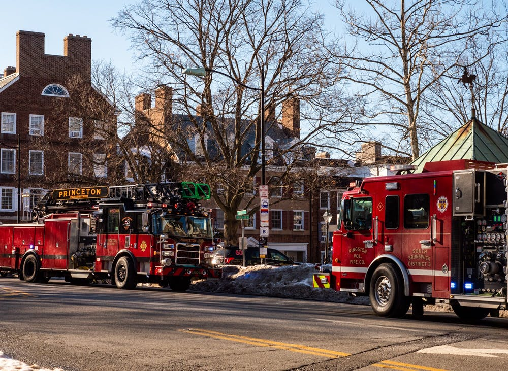 <h5>Fire trucks on Nassau Street. &nbsp;</h5> <h6>Candace Do / Daily Princetonian</h6>