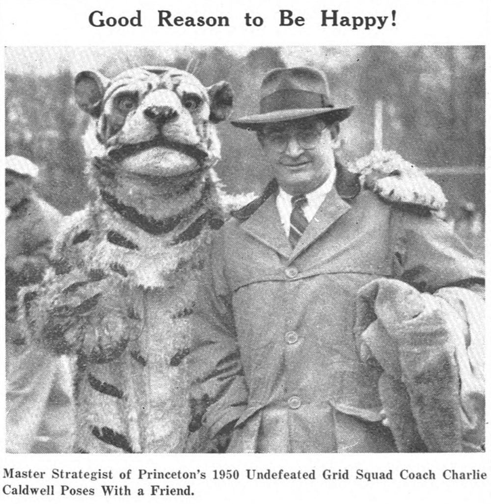 <p>Coach Charlie Caldwell posing with the Tiger mascot.</p> <h6>Photo appeared in the original Daily Princetonian article on November 27, 1950.</h6>
