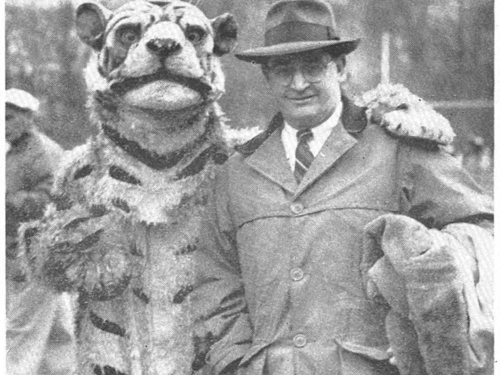 Coach Charlie Caldwell posing with the Tiger mascot. Photo appeared in the original Daily Princetonian article on November 27, 1950.