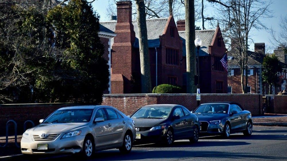 Cars parked along Prospect Avenue. Photo Credit: Jon Ort / The Daily Princetonian