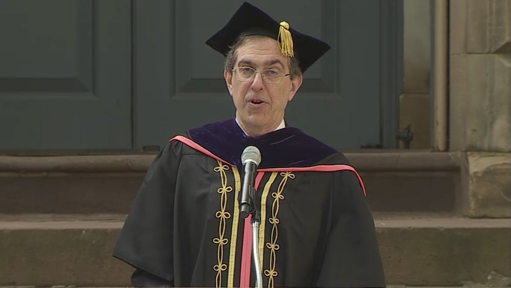 A screenshot of President Christopher Eisgruber '83 addressing the Class of 2020 during their virtual ceremony.    Here is some random stuff to test alt text functionality.