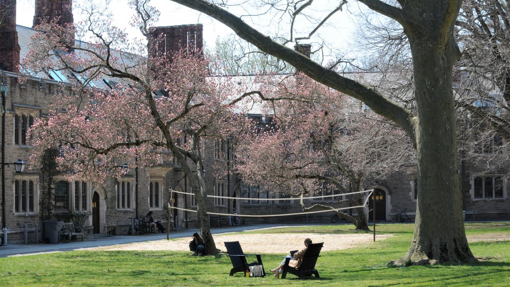 Students relax and study in the Blair-Joline Courtyard under blooming trees.  Justin Cai / The Daily Princetonian