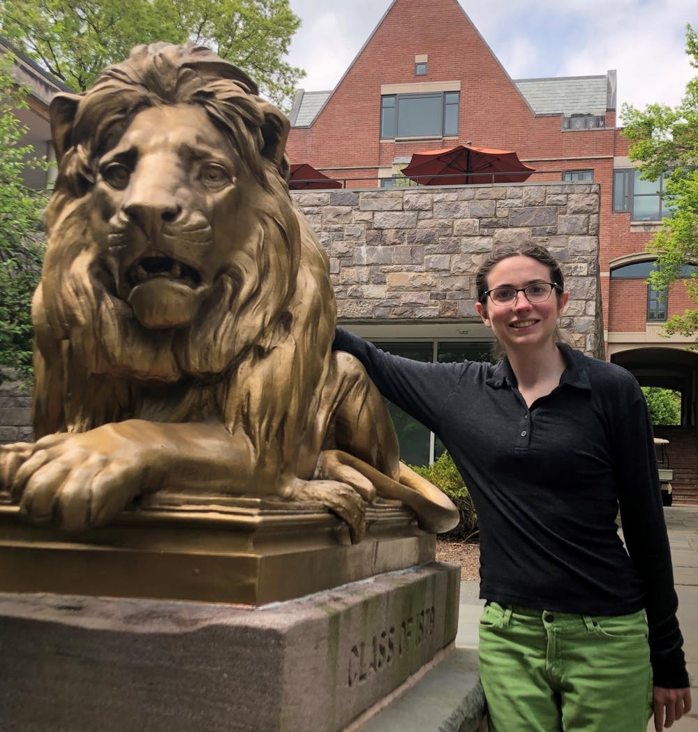 "<h6>""Proud Wilsonite"" and salutatorian Grace Sommers posing in front of her former residential college.</h6> <h6>Courtesy of Grace Sommers '20&nbsp;</h6>"