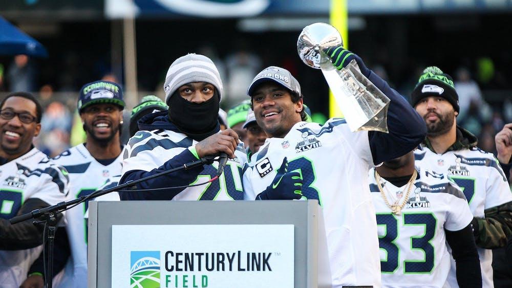 Marshawn Lynch (left) celebrates the Super Bowl XLVIII victory alongside quarterback Russell Wilson (right). Photo Credit: andrewtat94 / Flickr