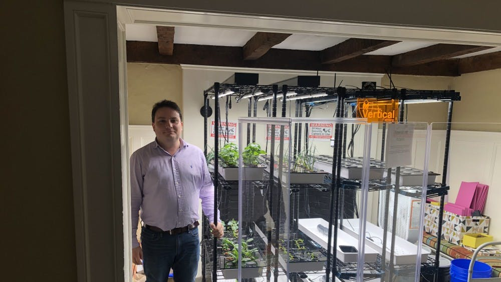 Paul Gauthier, associate researcher, stands in front of the Forbes hydroponic farm.