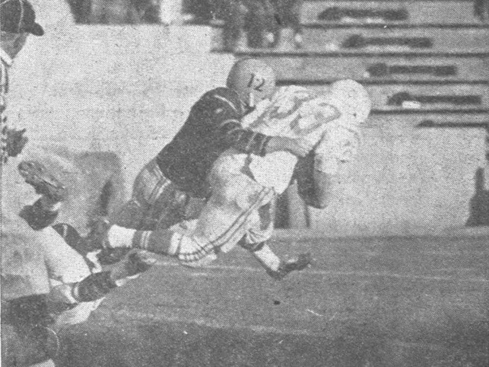 "The original caption reads: ""ALMOST PAYDIRT: Tiger Chuck Merlini flattens Cornell fullback Bill Wilson with a bone-crushing tackle on the Princeton seven."" Photo Credit: Keith Roe for The Daily Princetonian"
