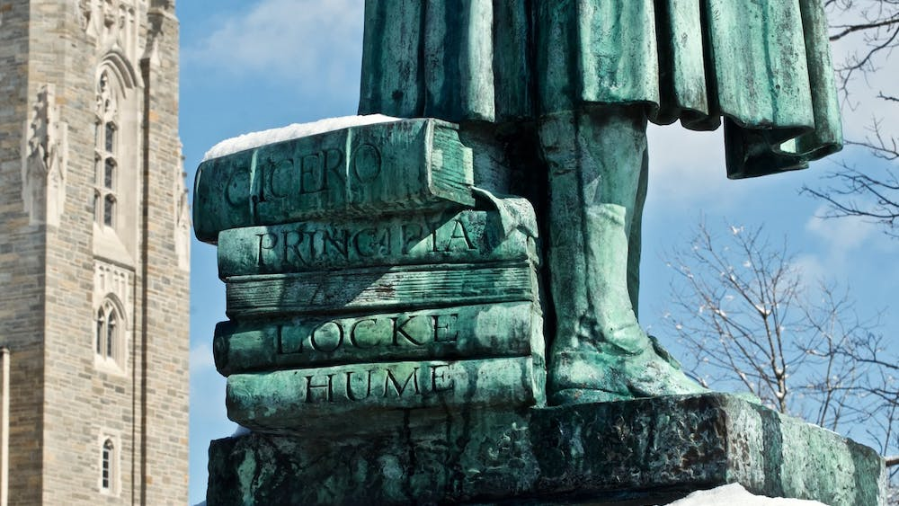 A stack of books beneath the feet of the John Witherspoon statue on campus, located in front of East Pyne. Photo courtesy of © Richard Trenner '70