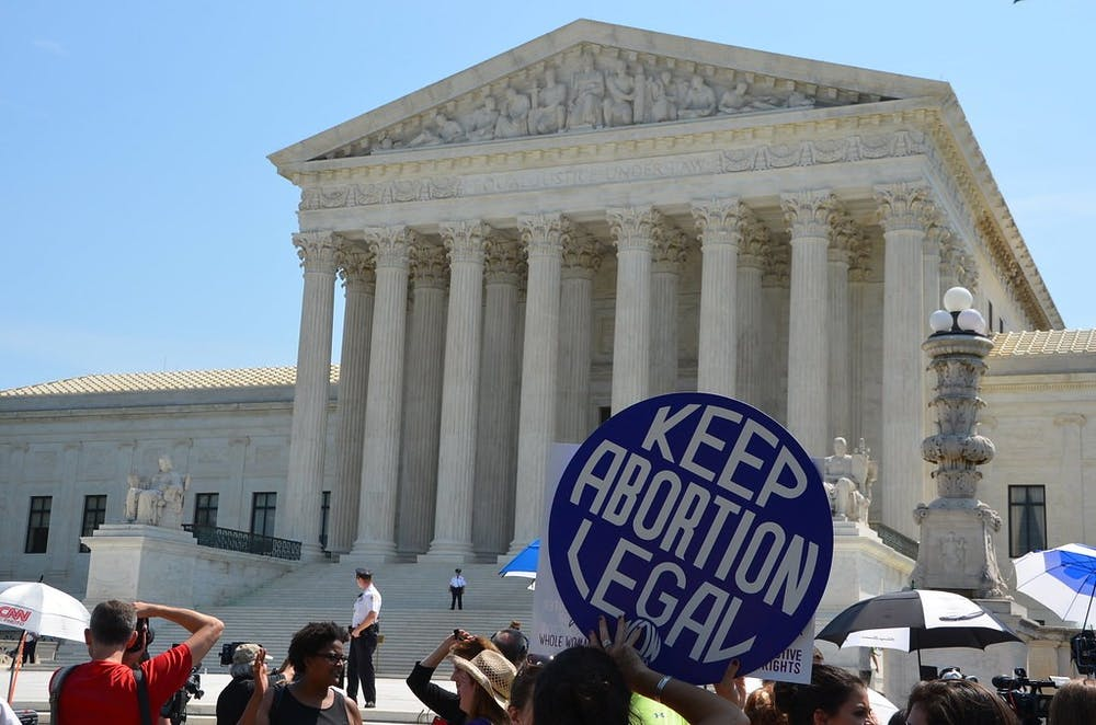 """<h5>Scene outside Supreme Court after decision on Texas abortion case</h5> <h6>""""<strong>Supreme Court keeps abortion legal</strong>"""" by Adam Fagen / <a href=""""https://www.flickr.com/photos/afagen/28521172920"""" target=""""_self"""">CC BY 2.0</a></h6>"""