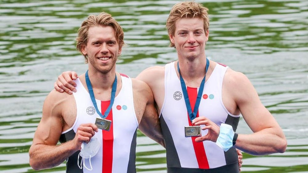 """<h5>Fred Vystavel '16 (left) and his partner Joachim Sutton</h5> <h6>Photo via <a href=""""https://goprincetontigers.com/news/2021/7/28/heavyweight-rowing-tokyo-olympics-all-four-heavweight-rowing-alums-will-race-for-medals.aspx"""" target=""""_self"""">goprincetontigers.com</a></h6>"""
