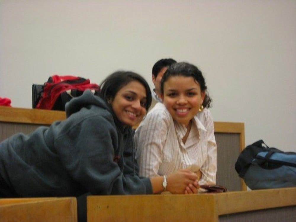 Harper and State Department employee Sandya Das GS '10 attend a lecture in Robertson Hall during their time at the Woodrow Wilson School  Courtesy of Morgan Harper