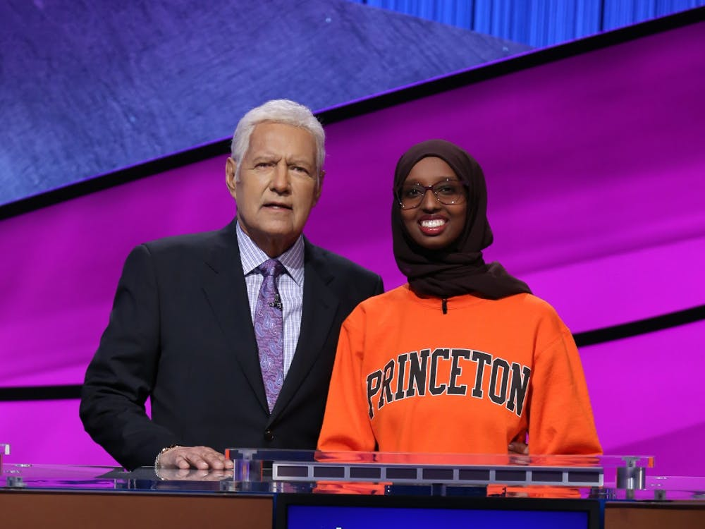 Sirad Hassan '20 with Jeopardy! host Alex Trebek. Courtesy of Sirad Hassan