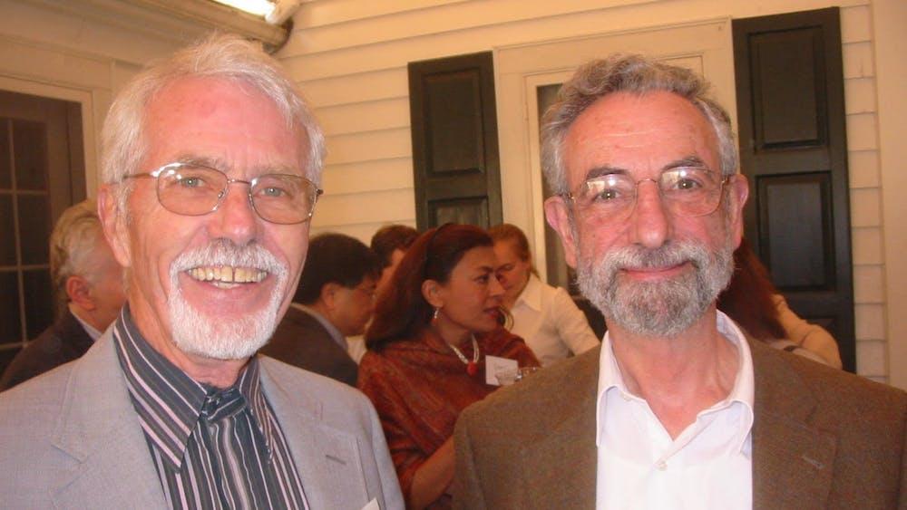 Pierre AdrienPiroué, on the left, with Elliot H. Lieb, Eugene Higgins Professor of Physics, Emeritus, at Department of Physics picnic. Photo Courtesy of Kirk T. McDonald