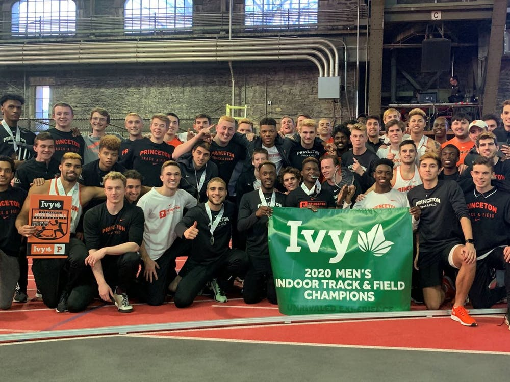 Men's track & field team display their Ivy League Indoor Champions banner. Photo courtesy of GoPrincetonTigers.com