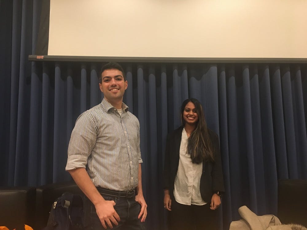 <p>Candidates David Esterlit '21 and Chitra Parikh '21 pose following the USG presidential debate.</p> <h6>Photo Credit: Evelyn Doskoch / The Daily Princetonian</h6>