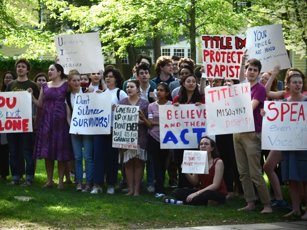 Students protest against the University's enforcement of Title IX regulations. Mark Dodici / The Daily Princetonian