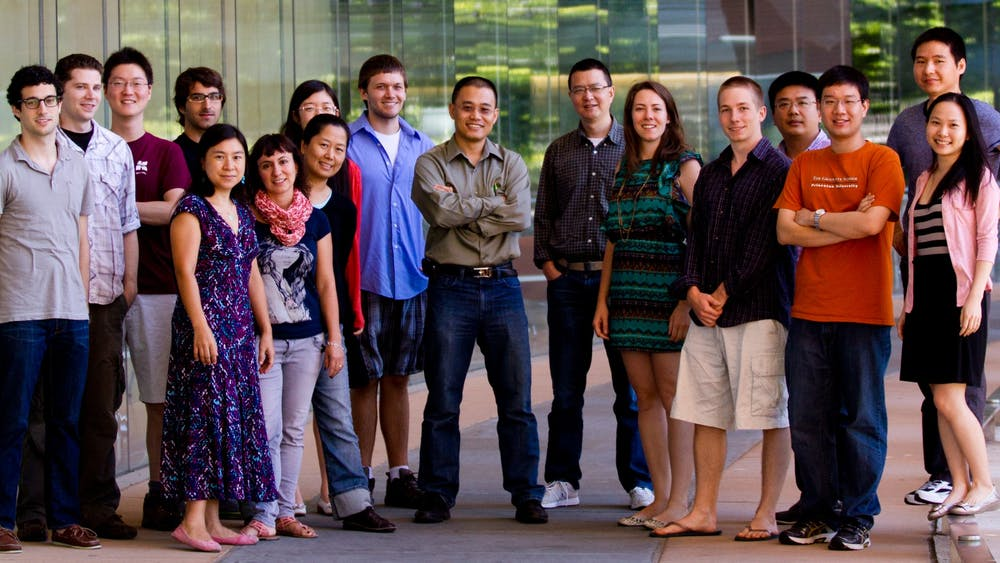 Professor Yibin Kang and his lab group. Professor Kang is located in the center, and Mark Esposito is located fifth from the right.   Courtesy of Maša Alečković