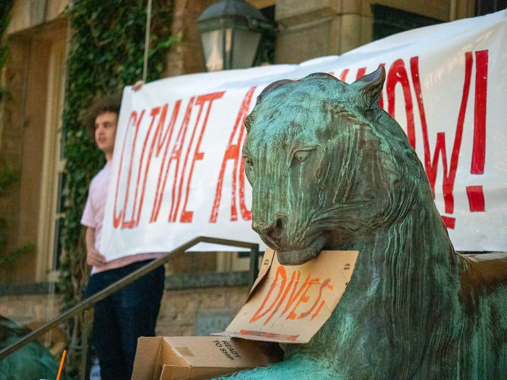 <h5>Students urge the University to divest fully from fossil fuels in a Sep. 24 sit-in at Nassau Hall.</h5> <h6>Candace Do / The Daily Princetonian</h6>