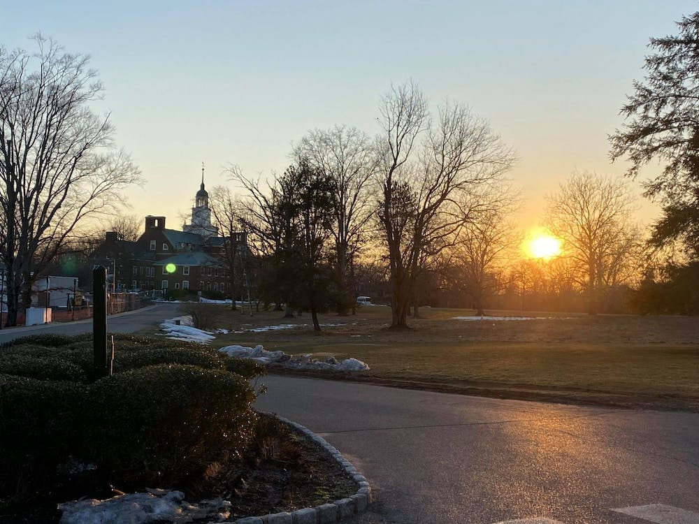 <h5>A sunset over Fuld Hall of the Institute of Advanced Study.</h5> <h6>Justin Cai / The Daily Princetonian</h6>