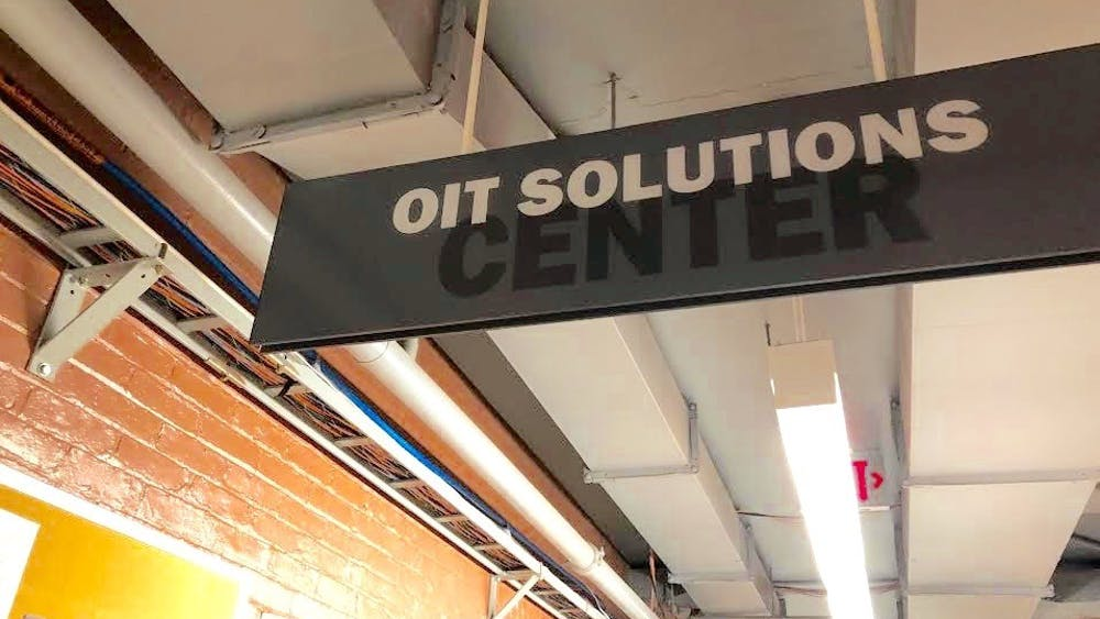 A sign for the OIT Solutions Center hangs in the 100 level of Princeton's Frist Center.