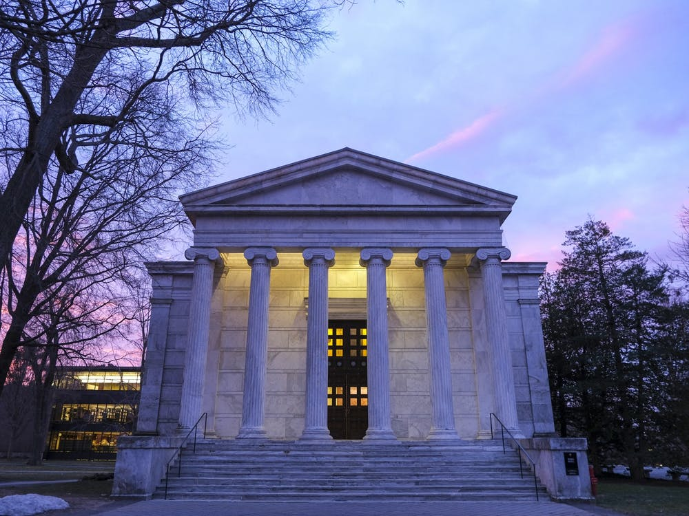 Whig Hall under the faint glow of a Tuesday morning sunrise.Timothy Park / The Daily Princetonian
