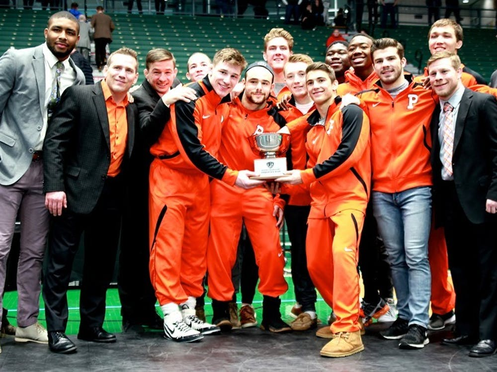Princeton wrestling poses with its hardware after a third-place EIWA finish. Photo Credit: Lisa Elfstrum \ goprincetontigers.com