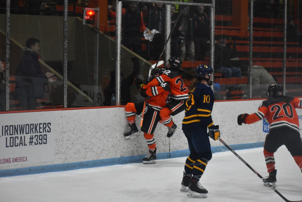 <p>Women's hockey players celebrating after their double overtime win against Quinnipiac.</p> <h6>Photo Credit: Owen Tedford / The Daily Princetonian</h6>