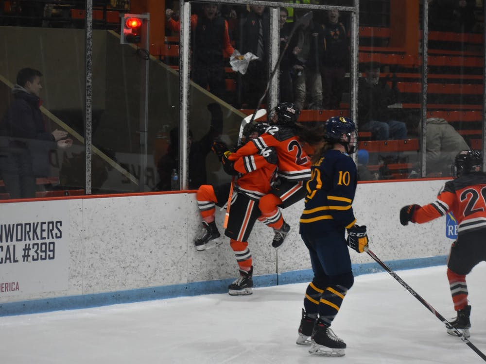 Women's hockey players celebrating after their double overtime win against Quinnipiac. Photo Credit: Owen Tedford / The Daily Princetonian
