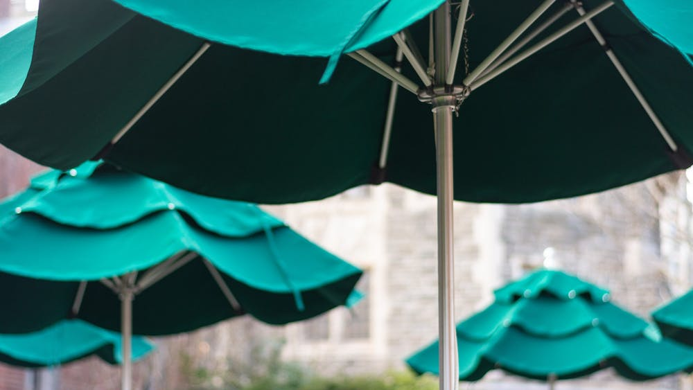 Umbrellas recently erected outside the WuCox Dining Hall offer a shady place to study or eat. Julian Gottfried / The Daily Princetonian