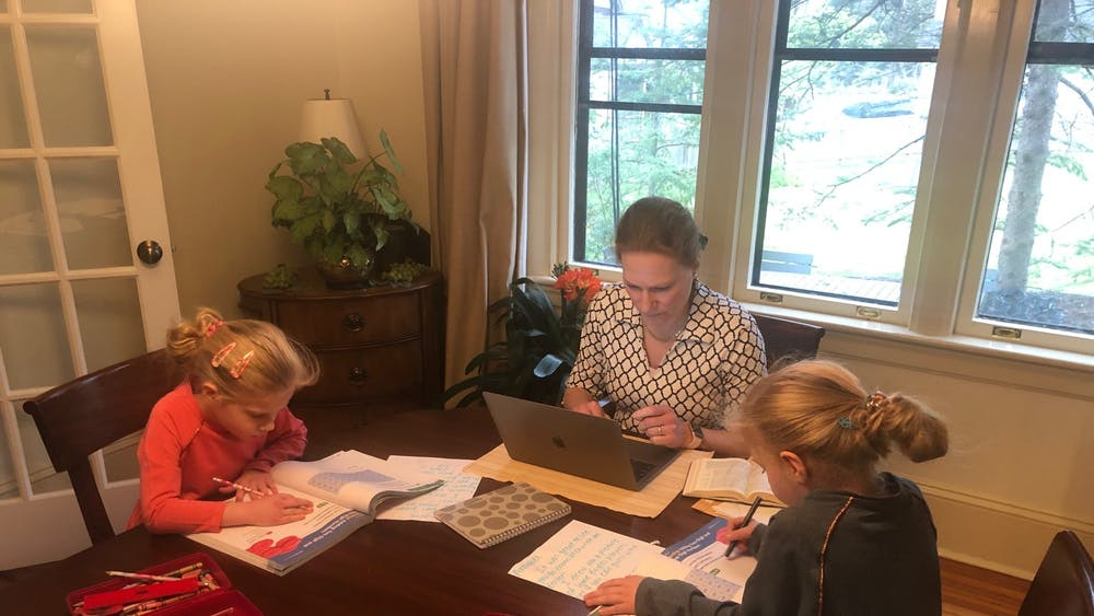 Professor of Religion and Head of Wilson College AnneMarie Luijendijk and her children, Annabel and Rosemarie, at their work station. Courtesy of AnneMarie Luijendijk