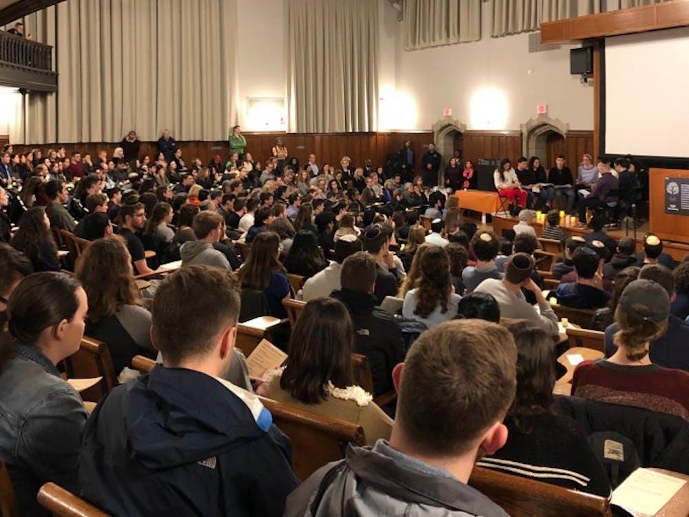 University community fills the McCosh 50 auditorium for the Pittsburgh vigil.
