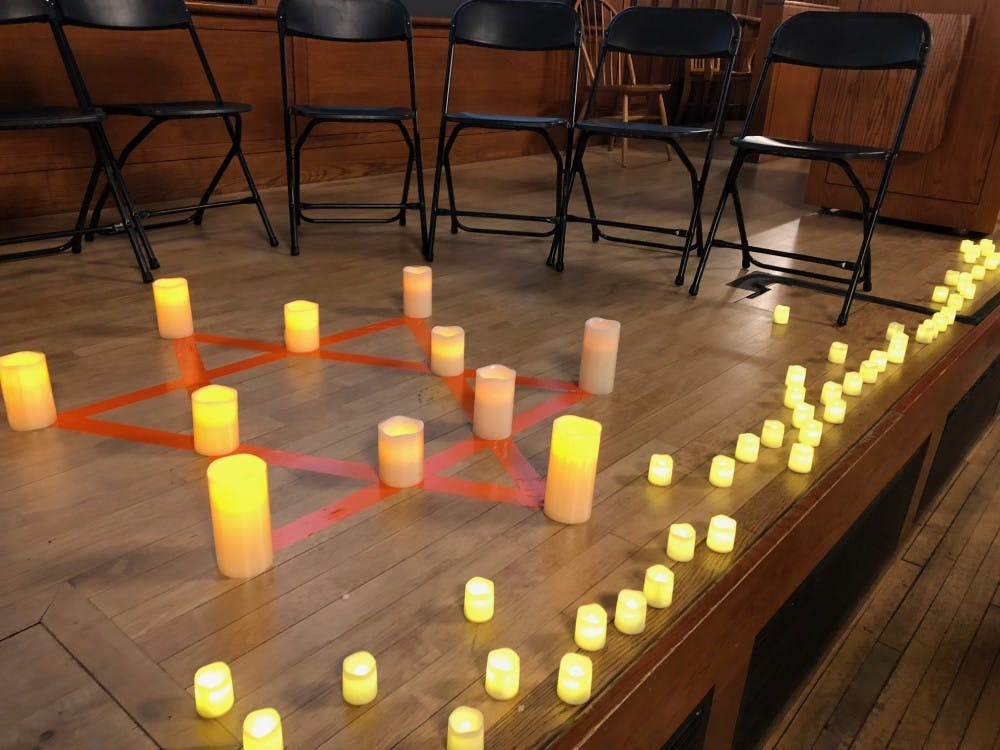 Memorial candles are lit at the Pittsburgh vigil.