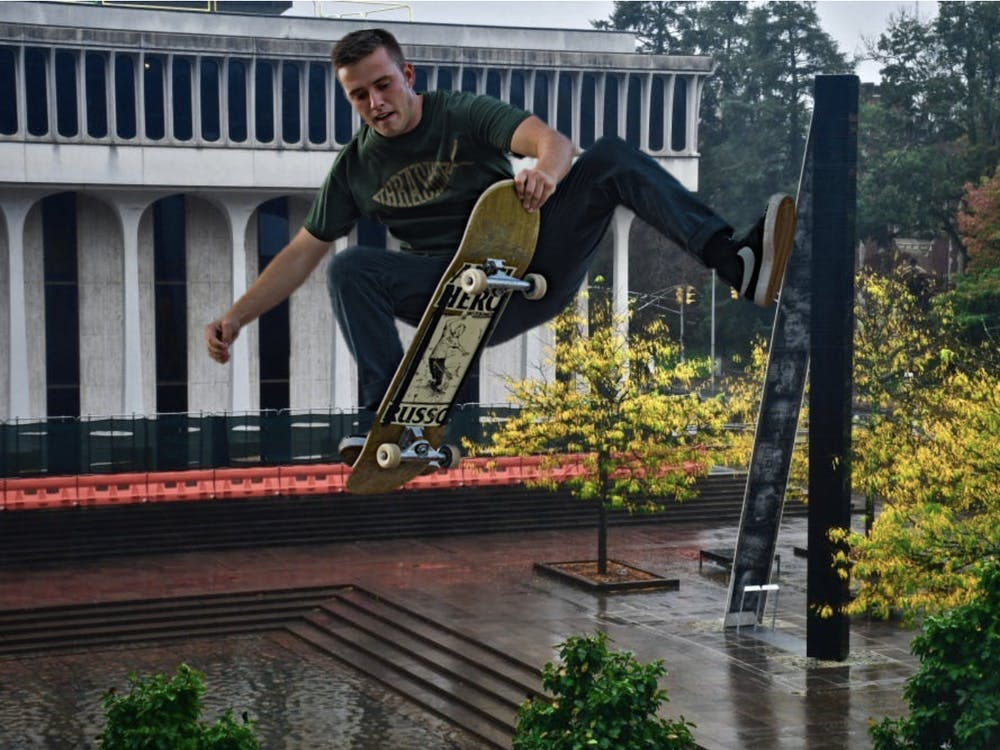 """Local skater practices tricks off of the side of """"Double Sights"""" Photo Credit: Jon Ort / The Daily Princetonian and Tech Sgt. Natasha Stannard / U.S. Air Force"""