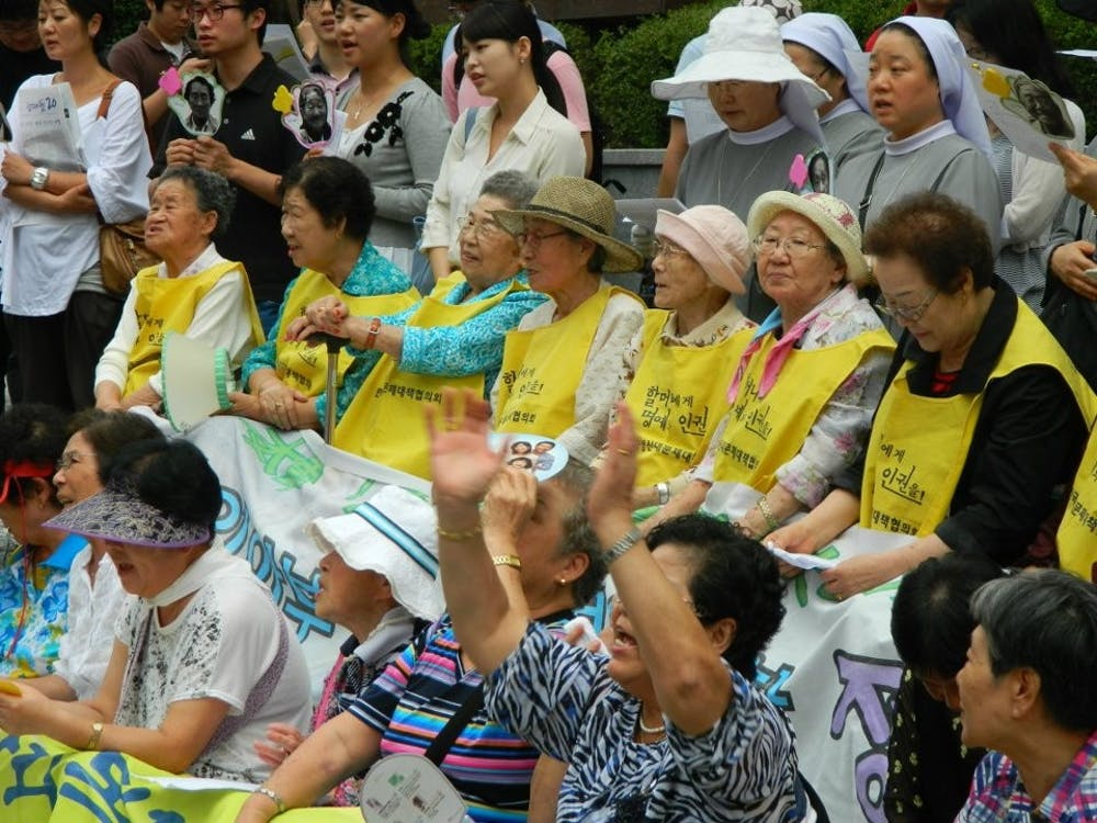 """<p>A 2011 rally, held to demand justice for so-called """"comfort women,"""" held in front of the Japanese Embassy in Seoul.</p> <h6>Photo Courtesy of Claire Solery / <a href=""""https://commons.wikimedia.org/wiki/File:Comfort_Women,_rally_in_front_of_the_Japanese_Embassy_in_Seoul,_August_2011_(2).jpg"""" target=""""_self"""">Wikimedia Commons</a></h6>"""