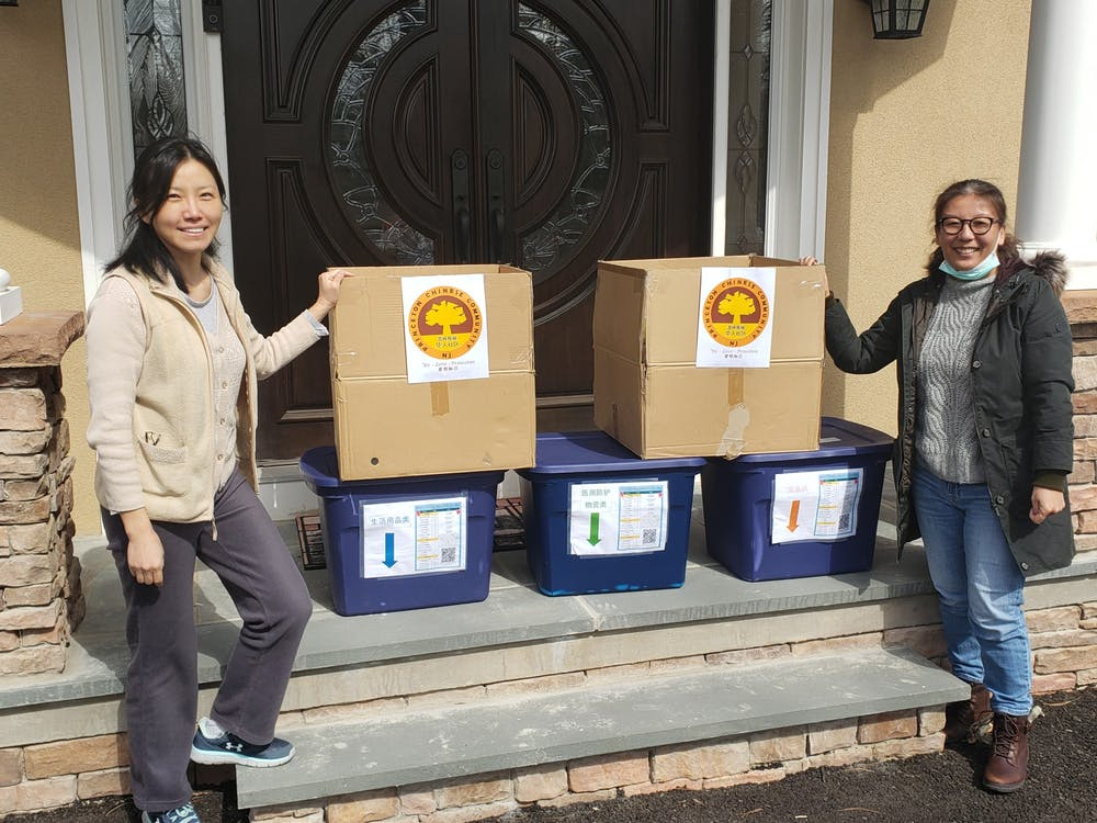 <h6>Cecilia Birge and Xiaobing Li pose with donated Personal Protective Equipment.</h6> <h6>Courtesy of Cecilia Birge / Princeton Chinese Community</h6>