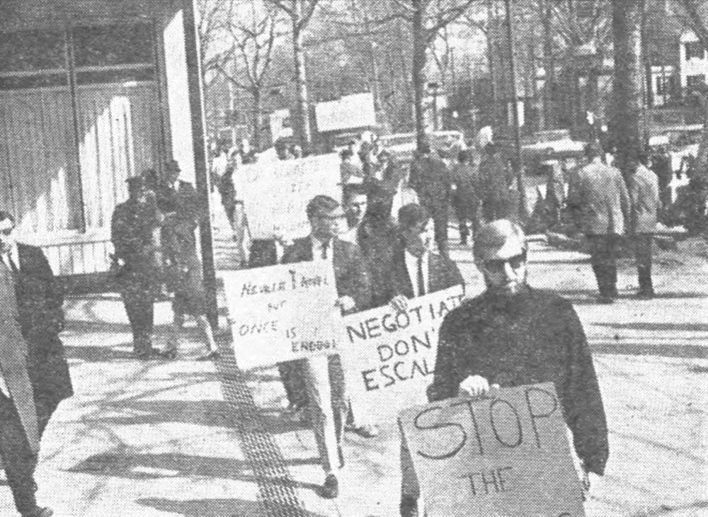 <p>On March 4, 1965, the two opposing pickets in Palmer Square were orderly and calm; some demonstrators ducked into delicatessens partway through for lunch.</p> <h6>Photo Credit: Jonathan Gunter '68 / The Daily Princetonian</h6>