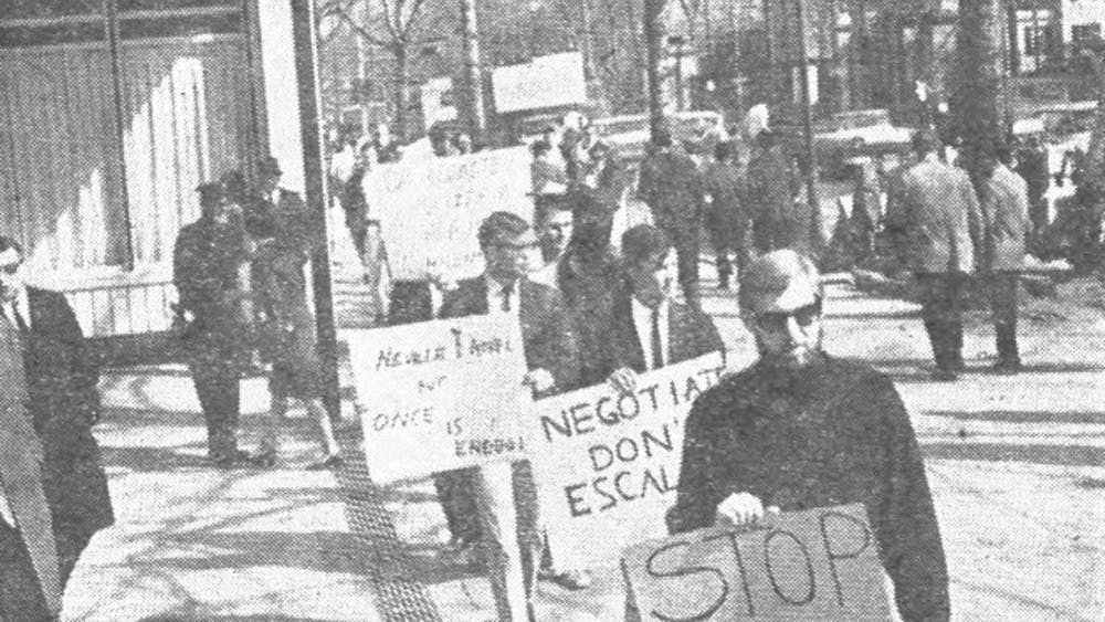 On March 4, 1965, the two opposing pickets in Palmer Square were orderly and calm; some demonstrators ducked into delicatessens partway through for lunch. Photo Credit: Jonathan Gunter '68 / The Daily Princetonian