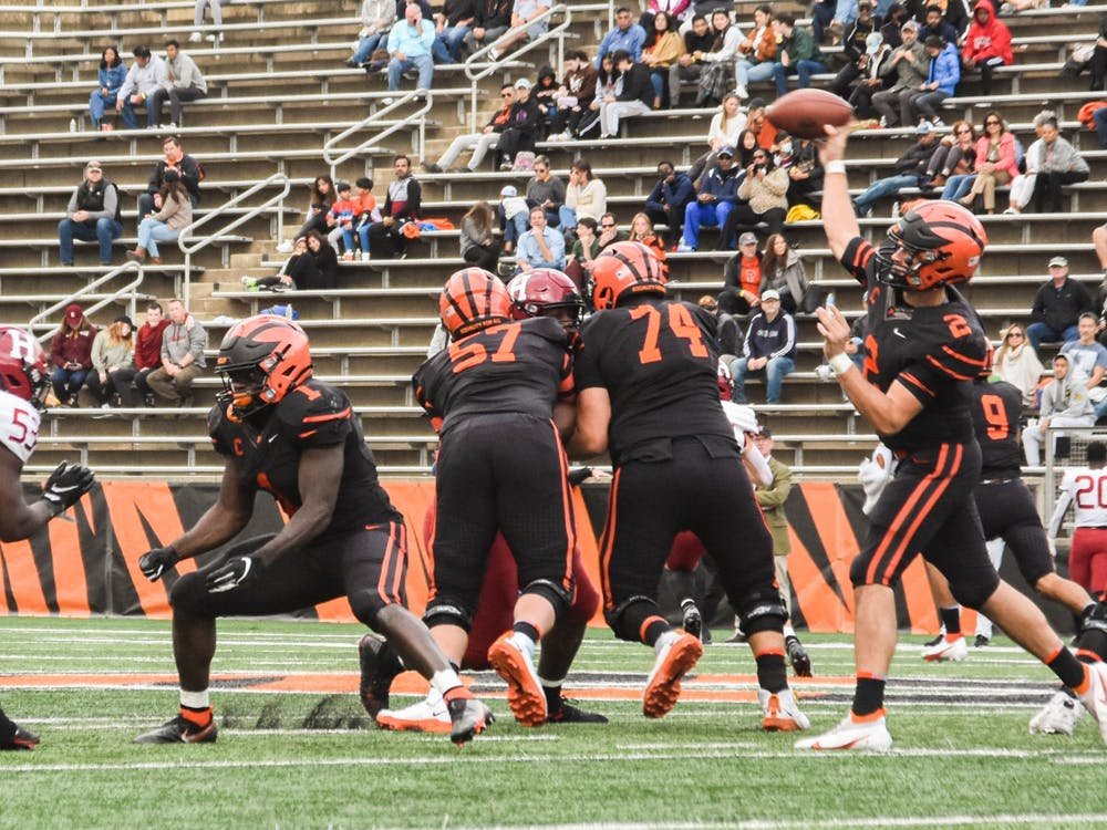Senior quarterback Cole Smith drops back to pass in Princeton's matchup against Harvard. Mark Dodici / The Daily Princetonian