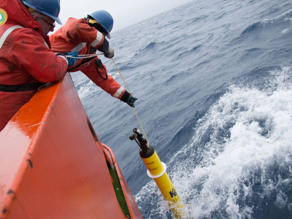 Researchers submerge a single SOCCOM robotic float into the Southern Ocean. Several floats constitute an array that communicates collected biogeochemical data with satellites that hover over the Southern Ocean. Courtesy of SOCCOM Project, Princeton University