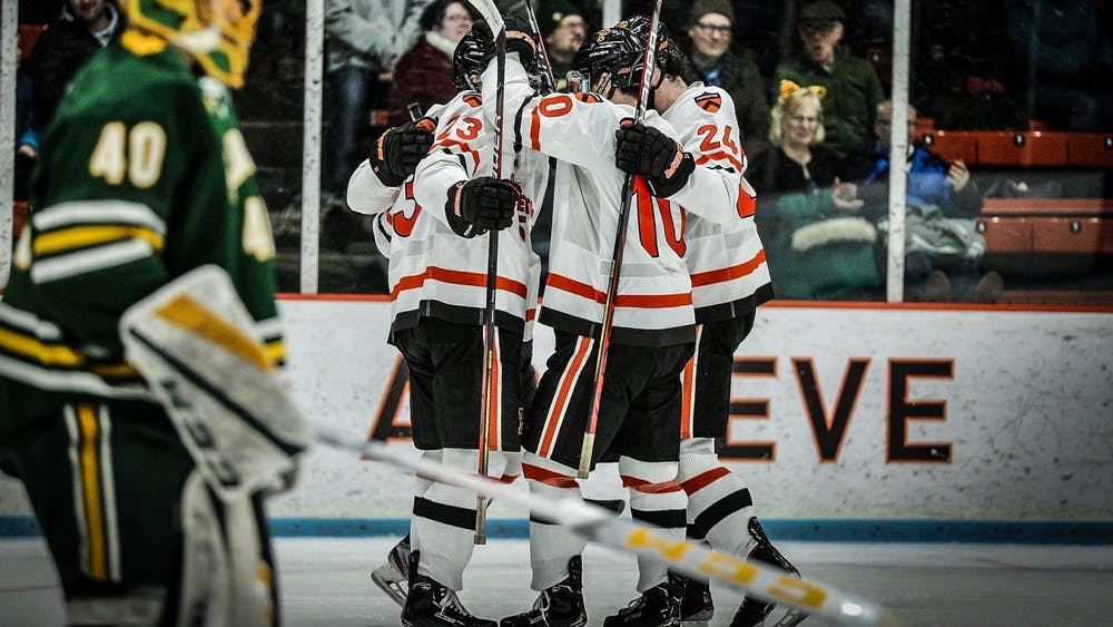 Men's hockey celebrates after a goal against no. 5 Clarkson. Photo courtesy of Shelley Szwast / GoPrincetonTigers