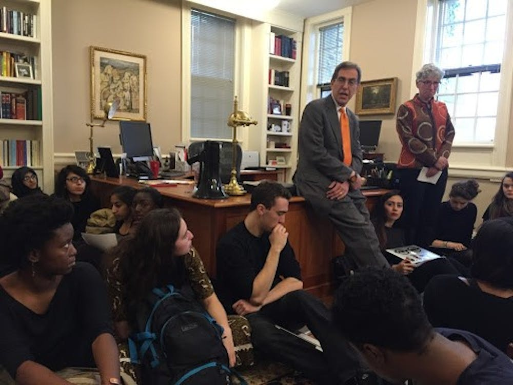 <h5>Students in President Eisgruber's office on Nov. 18, 2015.</h5> <h5>Courtesy of University Press Club live-blog, 2015</h5>