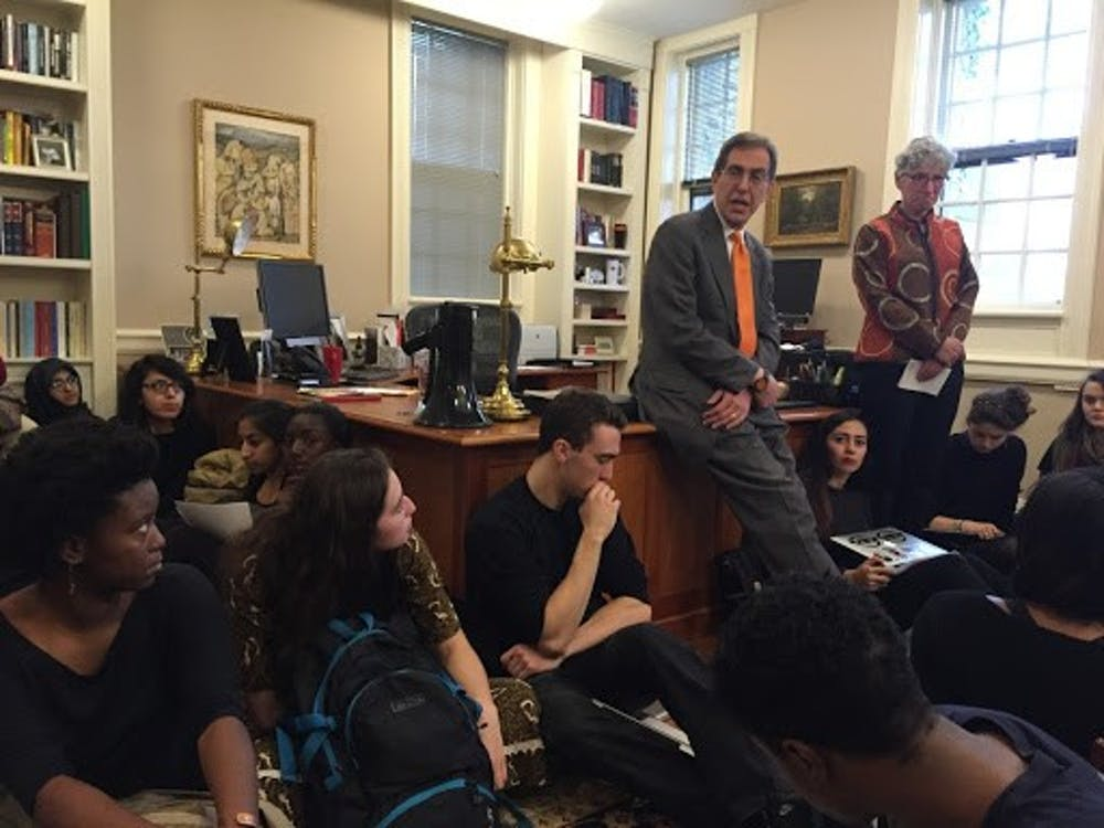 Students in President Eisgruber's office on Nov. 18, 2015. Courtesy of University Press Club live-blog, 2015