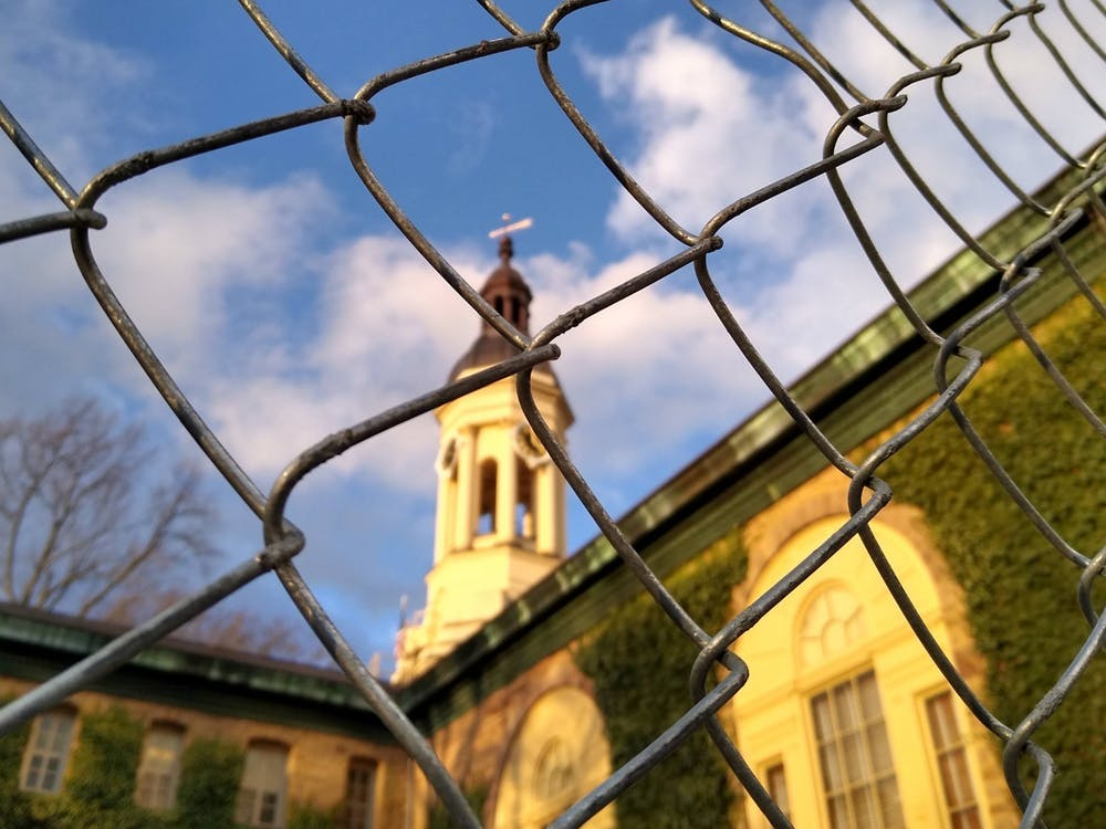 <h5>Nassau Hall through a chain-link fence as it undergoes construction to make it more accessible.</h5> <h6>Mark Dodici / The Daily Princetonian</h6>