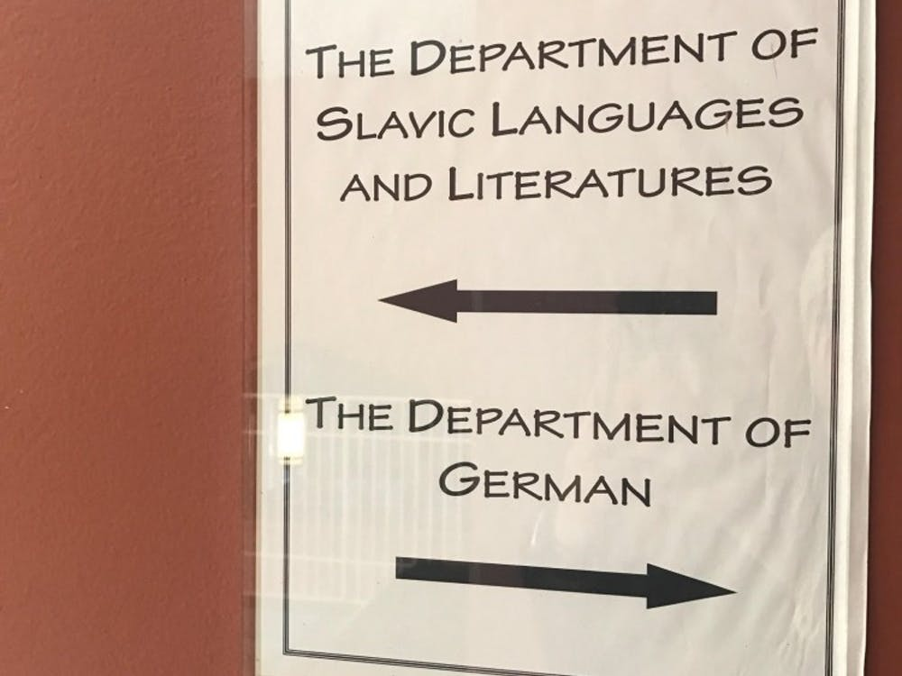 Signs directing towards departmental offices inside East Pyne; most University departments, like German, are small.