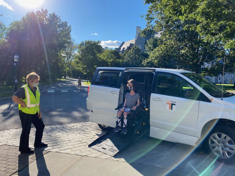 Naomi Hess '22 exiting the TigerAccess van Tess Weinreich / The Daily Princetonian