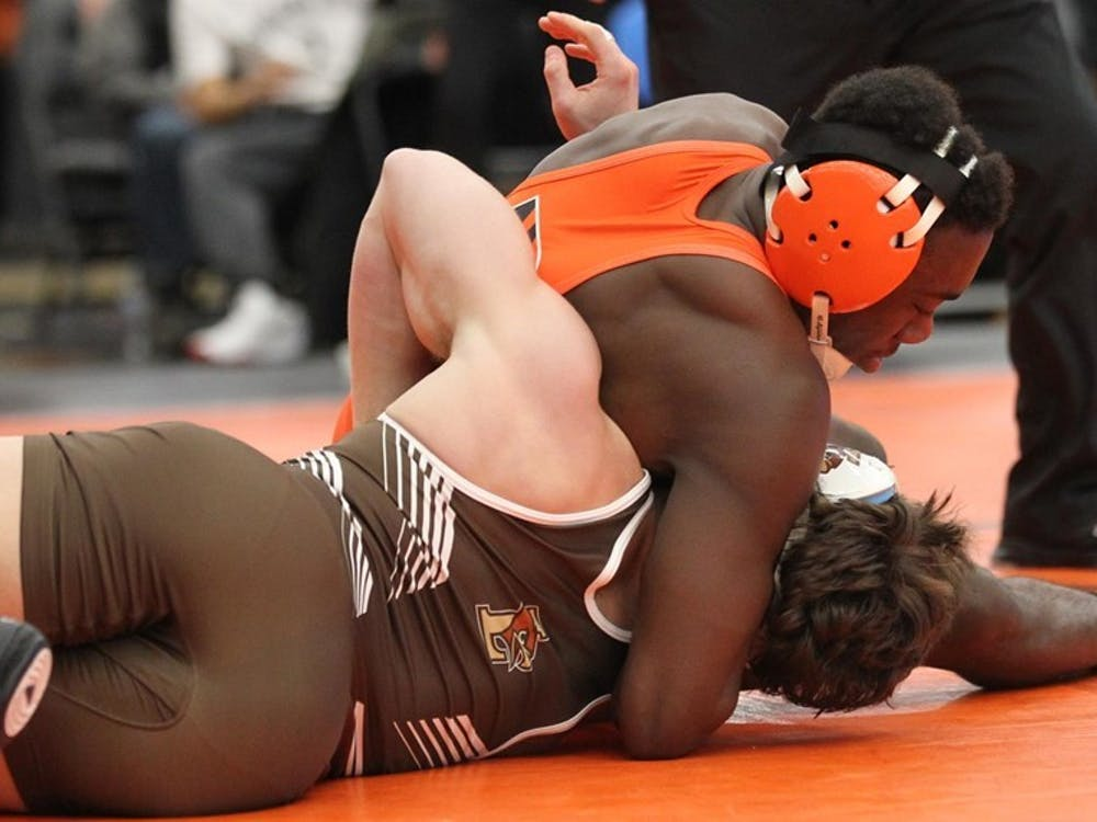 Sophomore Quincy Monday, with Lehigh's Josh Humphreys in a headlock.  Photo credit: GoPrincetonTigers.