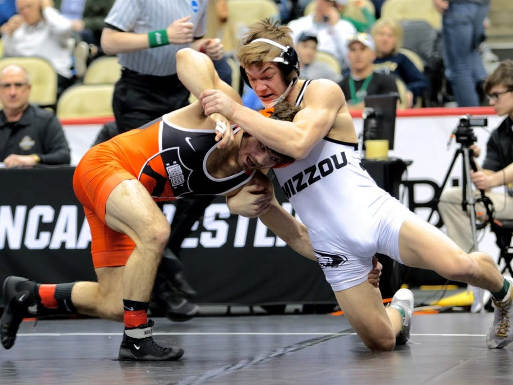 Junior and three-time All-American Matthew Kolodzik readies an opponent for a takedown. photo credit: Lisa Elfstrum for the Daily Princetonian