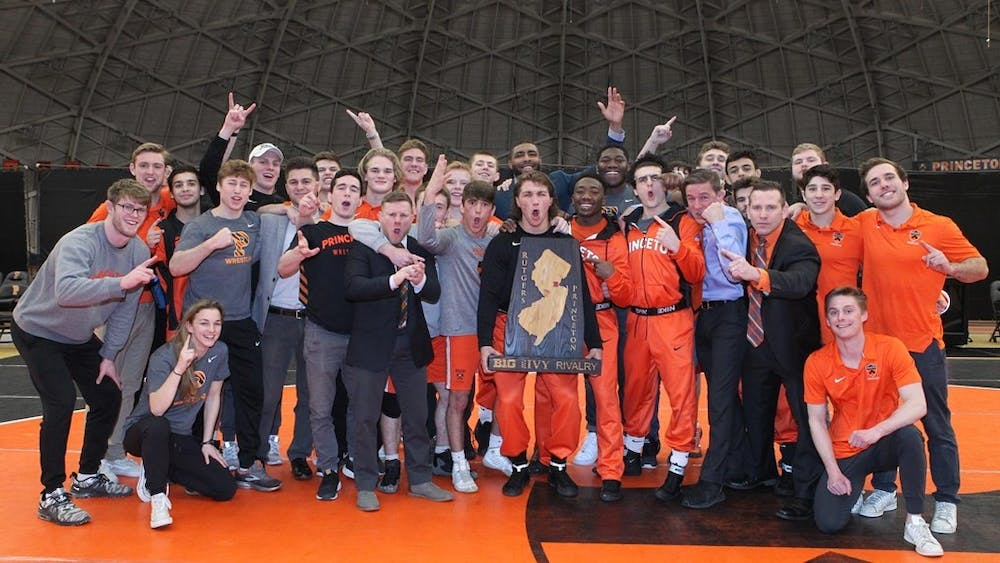 Wrestling poses with the B1G-Ivy trophy. Photo credit: Beverly Schaefer, GoPrincetonTigers.