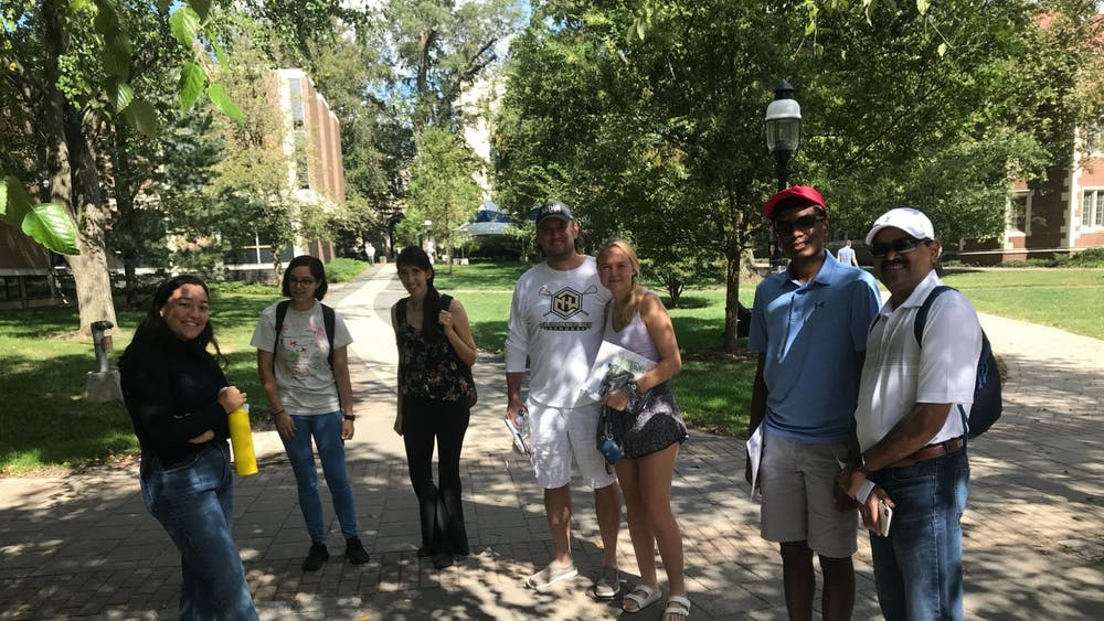 Sakura Price '23 (left) and her tour group, including high school senior Erika Petterson and her father, Chad Petterson (center). Edward Tian / The Daily Princetonian