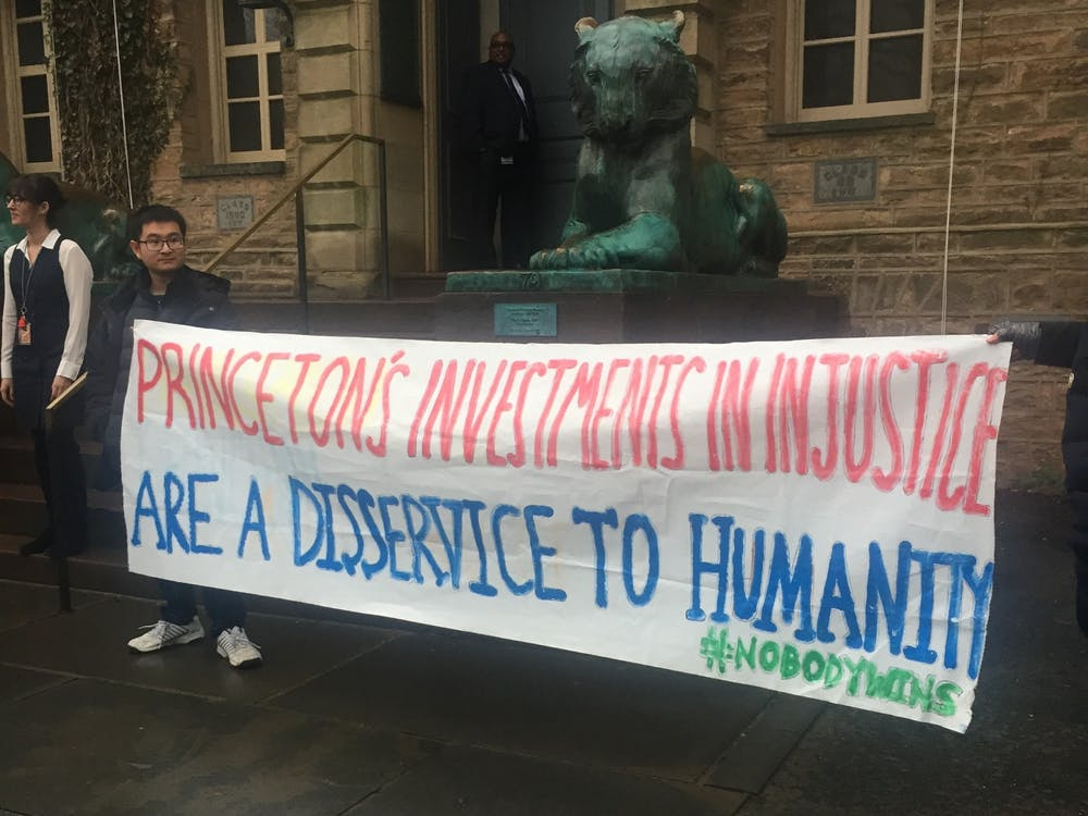 Divest Princeton protestors outside Nassau Hall. Rooya Rahin / The Daily Princetonian